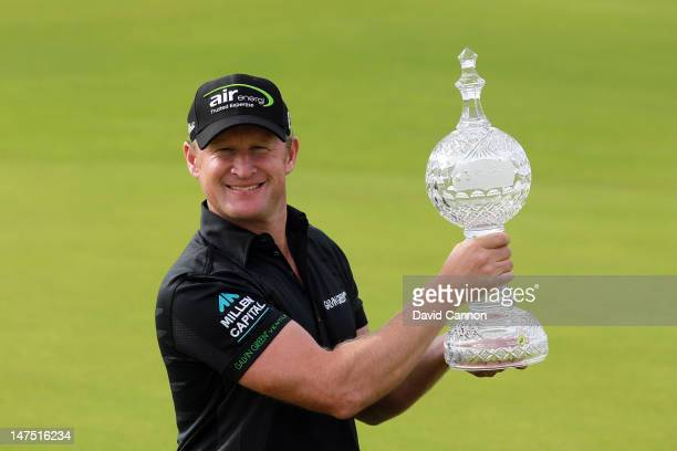 Jamie Donaldson of Wales holds the trophy after his first European Tour win during the final round of the 2012 Irish Open held on the Dunluce Links...