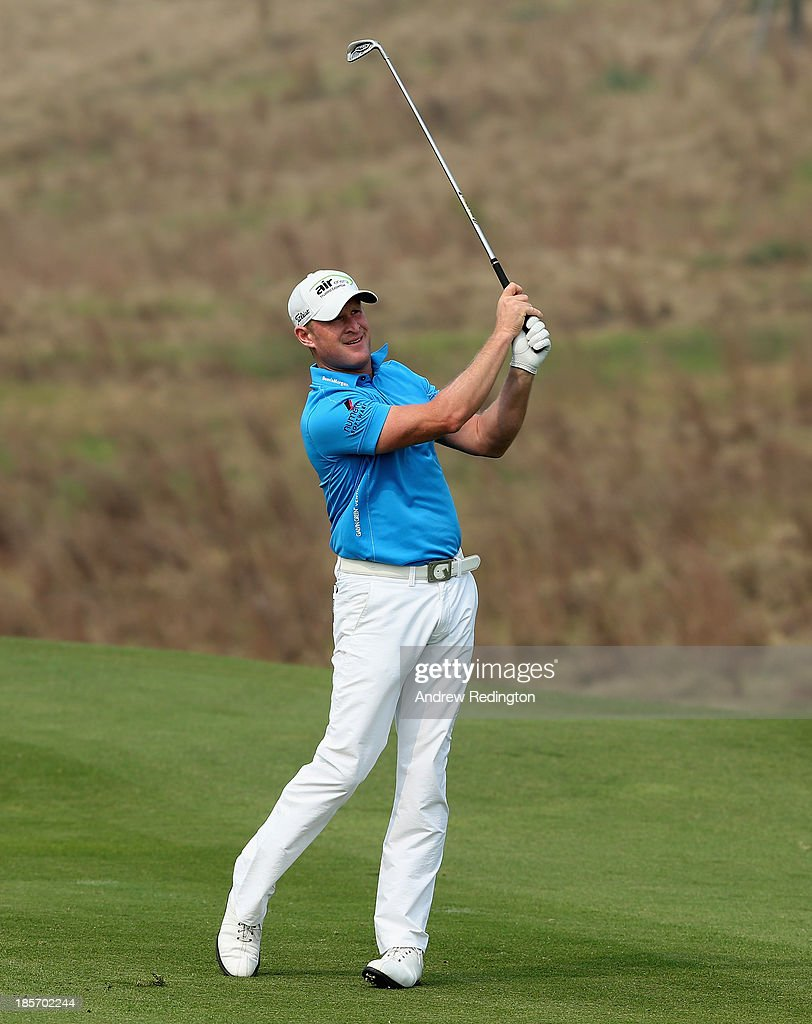 <a gi-track='captionPersonalityLinkClicked' href=/galleries/search?phrase=Jamie+Donaldson&family=editorial&specificpeople=241203 ng-click='$event.stopPropagation()'>Jamie Donaldson</a> of Wales in action during the first round of the BMW Masters at Lake Malaren Golf Club on October 24, 2013 in Shanghai, China.