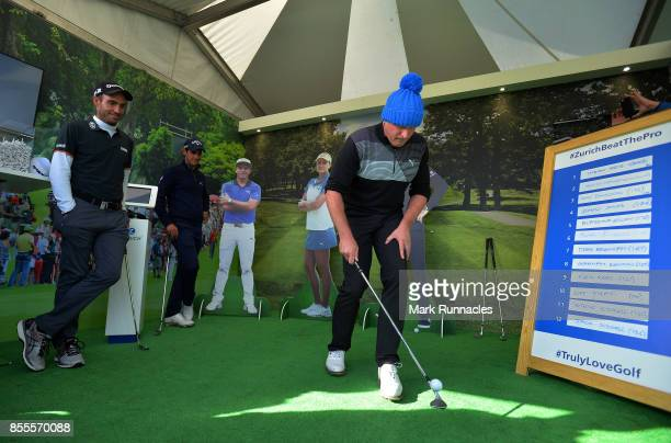 Jamie Donaldson of Wales is watched by Matteo Manassero of Italy and Edoardo Molinari of Italy as he takes part in the Keepy Uppys Challenge at the...