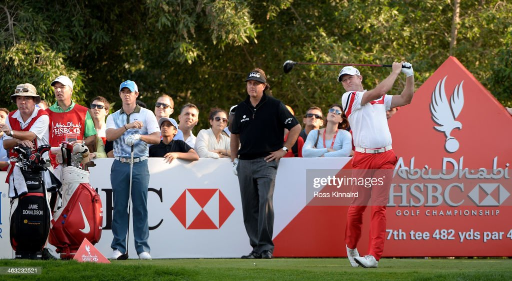 Jamie Donaldson of Wales is watched by Rory McIlroy of Northern Ireland and Phil Mickelson of the USA during the second round of the Abu Dhabi HSBC...