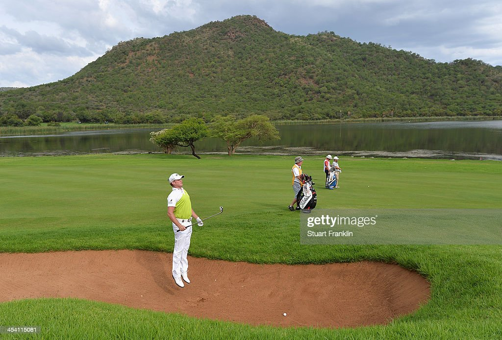 <a gi-track='captionPersonalityLinkClicked' href=/galleries/search?phrase=Jamie+Donaldson&family=editorial&specificpeople=241203 ng-click='$event.stopPropagation()'>Jamie Donaldson</a> of Wales jumps in the bunker on the 17th hole during the third round of the Nedbank Golf Challenge at Gary Player CC on December 7, 2013 in Sun City, South Africa.