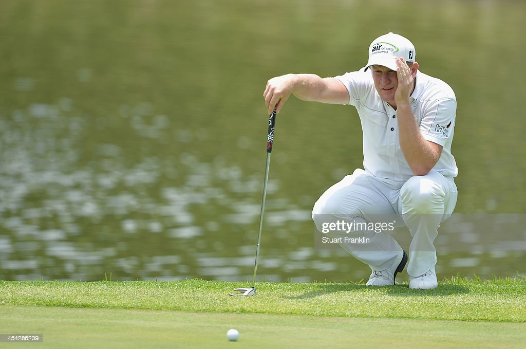 Jamie Donaldson of Wales lines up a putt during the final round of the Nedbank Golf Challenge at Gary Player CC on December 8, 2013 in Sun City, South Africa.