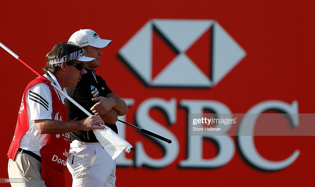 Jamie Donaldson of Wales looks over a putt on the 18th green alongside his caddie Mick Donaghy during the final round of the Abu Dhabi HSBC Golf Championship at Abu Dhabi Golf Club on January 20, 2013 in Abu Dhabi, United Arab Emirates.