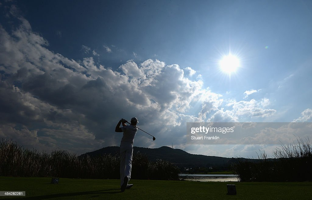 Jamie Donaldson of Wales plays a shot during the final round of the Nedbank Golf Challenge at Gary Player CC on December 8, 2013 in Sun City, South Africa.