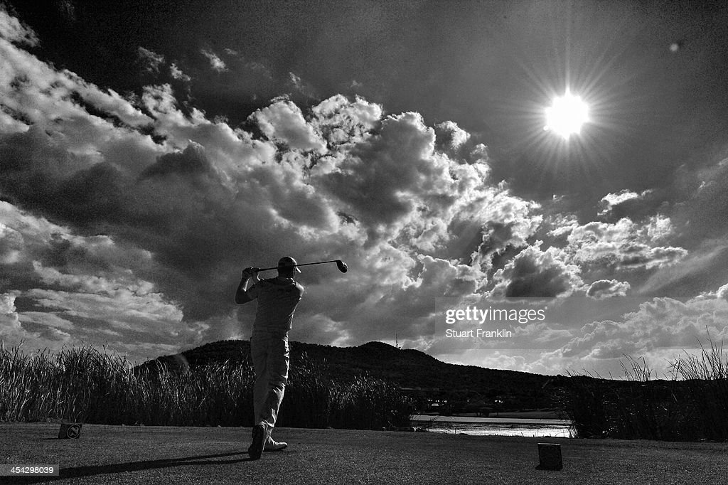 . Jamie Donaldson of Wales plays a shot during the final round of the Nedbank Golf Challenge at Gary Player CC on December 8, 2013 in Sun City, South Africa.