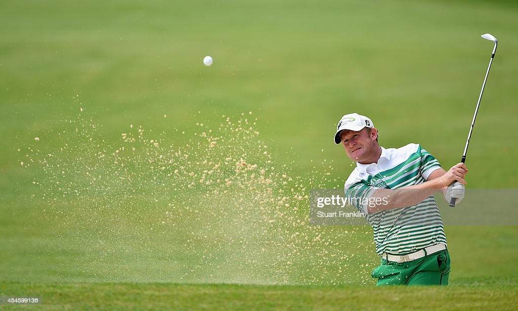 Jamie Donaldson of Wales plays a shot during the first round of the Omega European Masters at CranssurSierre Golf Club on September 4 2014 in...