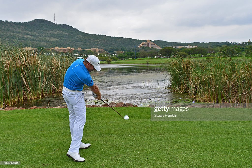 Jamie Donaldson of Wales plays a shot during the second round of the Nedbank Golf Challenge at Gary Player CC on December 6 2013 in Sun City South...