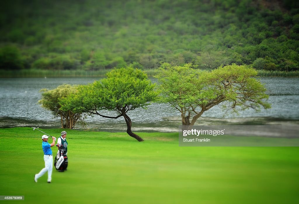 . Jamie Donaldson of Wales plays a shot during the second round of the Nedbank Golf Challenge at Gary Player CC on December 6, 2013 in Sun City, South Africa.