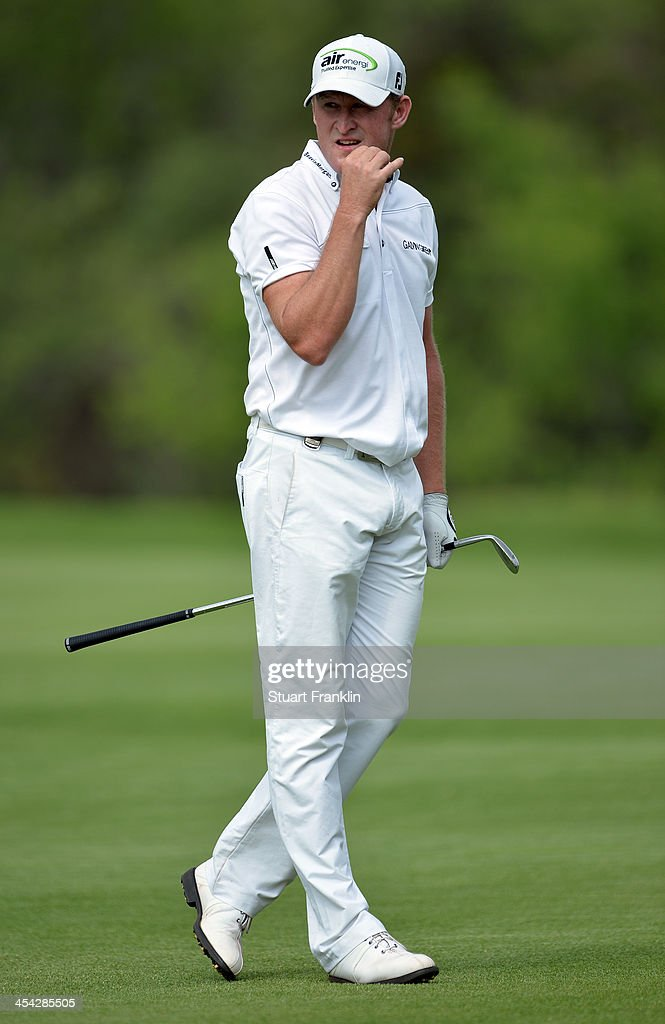 <a gi-track='captionPersonalityLinkClicked' href=/galleries/search?phrase=Jamie+Donaldson&family=editorial&specificpeople=241203 ng-click='$event.stopPropagation()'>Jamie Donaldson</a> of Wales reacts to a shot during the final round of the Nedbank Golf Challenge at Gary Player CC on December 8, 2013 in Sun City, South Africa.