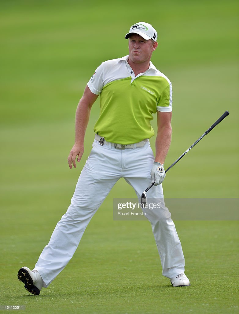 Jamie Donaldson of Wales reacts to a shot during the third round of the Nedbank Golf Challenge at Gary Player CC on December 7, 2013 in Sun City, South Africa.