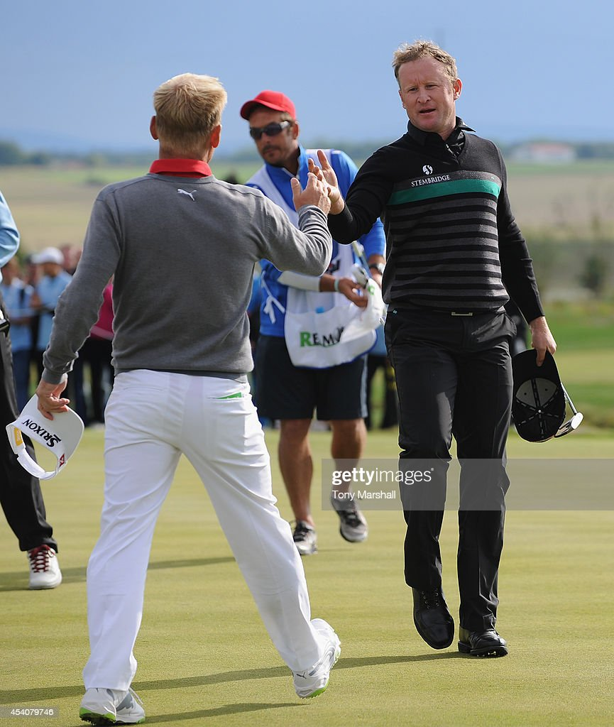 <a gi-track='captionPersonalityLinkClicked' href=/galleries/search?phrase=Jamie+Donaldson&family=editorial&specificpeople=241203 ng-click='$event.stopPropagation()'>Jamie Donaldson</a> of Wales shakes hands with <a gi-track='captionPersonalityLinkClicked' href=/galleries/search?phrase=Soren+Kjeldsen&family=editorial&specificpeople=242923 ng-click='$event.stopPropagation()'>Soren Kjeldsen</a> of Denmark afterwinning the D+D Real Czech Masters during day four of D+D REAL Czech Masters at Albatross Golf Resort on August 24, 2014 in Prague, Czech Republic.