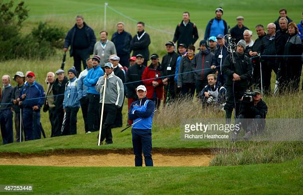 Jamie Donaldson of Wales stands in a bunker on the 17th that he took 3 shots to get out of during his first round match against Paul Casey of England...