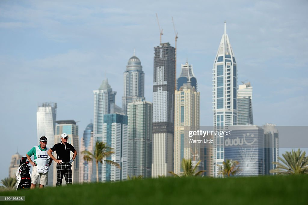 Jamie Donaldson of Wales stands with his caddie Michael Donaghy on the 13th hole during the second round of the Omega Dubai Desert Classic at Emirates Golf Club on February 1, 2013 in Dubai, United Arab Emirates.