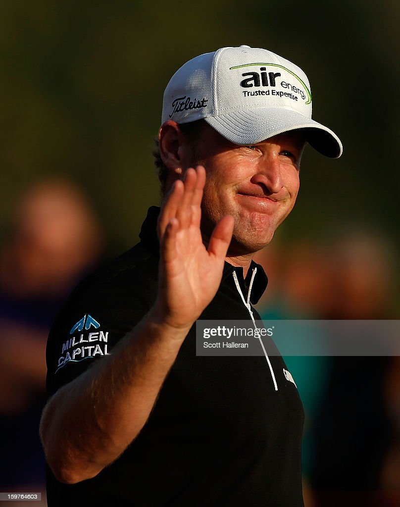 Jamie Donaldson of Wales waves to the gallery on the 18th green after winning the Abu Dhabi HSBC Golf Championship at Abu Dhabi Golf Club on January 20, 2013 in Abu Dhabi, United Arab Emirates.