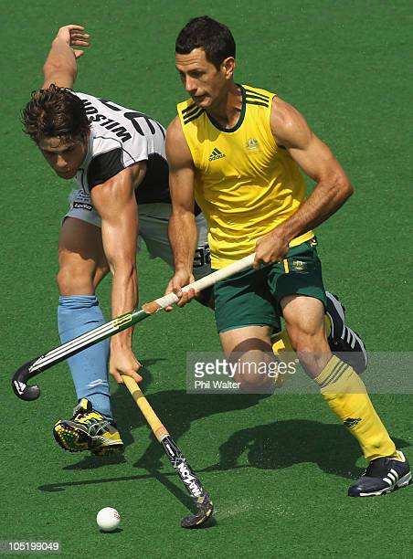 Jamie Dwyer of Australia and Nick Wilson of New Zealand compete for the ball during the mens hockey match between Australia and New Zealand at Major...