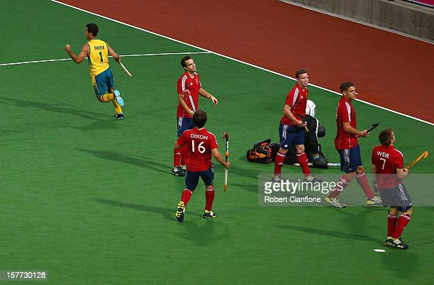 Jamie Dwyer of Australia celebrates after he scores the opening goal during the match between Australia and England on day four of the 2012 Champions...