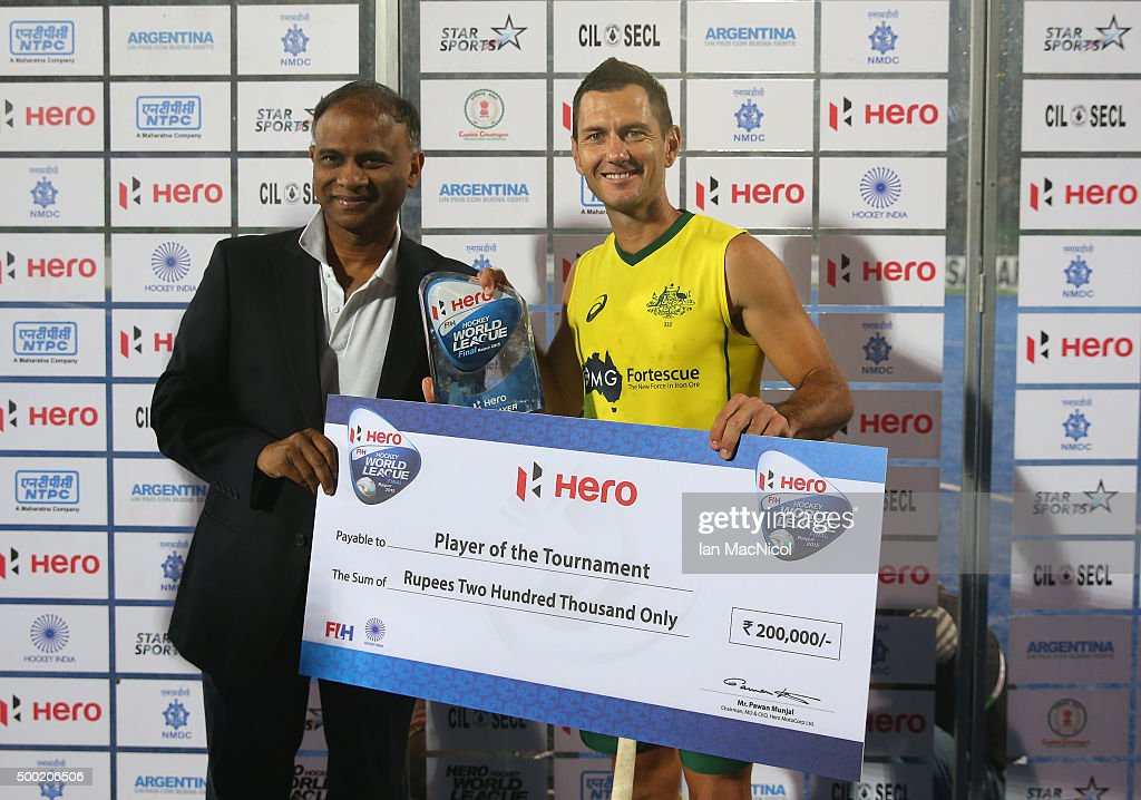 <a gi-track='captionPersonalityLinkClicked' href=/galleries/search?phrase=Jamie+Dwyer&family=editorial&specificpeople=728372 ng-click='$event.stopPropagation()'>Jamie Dwyer</a> of Australia receives his player of the tournament award after winning the final between Australia and Belgium on day ten of The Hero Hockey League World Final at the Sardar Vallabh Bhai Patel International Hockey Stadium on December 06, 2015 in Raipur, India.