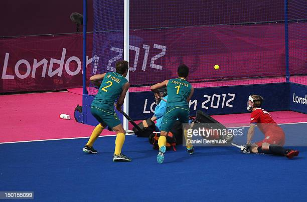 Jamie Dwyer of Australia scores his team's second goal against Great Britain during the Men's Hockey bronze medal match on Day 15 of the London 2012...