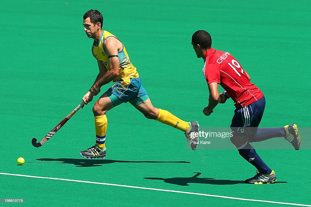 Jamie Dwyer of the Kookaburras controls the ball against Darren Cheesman of England in the mens Australia Kookaburras v England game during day three of the 2012 International Super Series at Perth Hockey Stadium on November 24, 2012 in Perth, Australia.