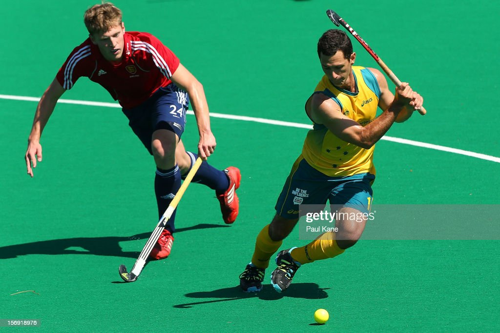 Jamie Dwyer of the Kookaburras takes a shot on goal against Oliver Willars of England in the gold medal match between the Australian Kookaburras and England during day four of the 2012 International Super Series at Perth Hockey Stadium on November 25, 2012 in Perth, Australia.