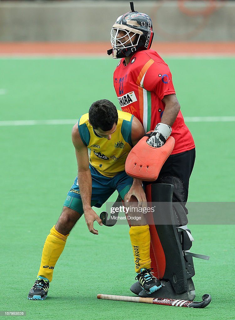 Jamie Dywer of Australia bumps into goal keeper Thirumala Roa Potunuri of India as he picks his stick up in the match between Australia and India during day five of the 2012 Champions Trophy at the State Netball and Hockey Centre on December 8, 2012 in Melbourne, Australia.