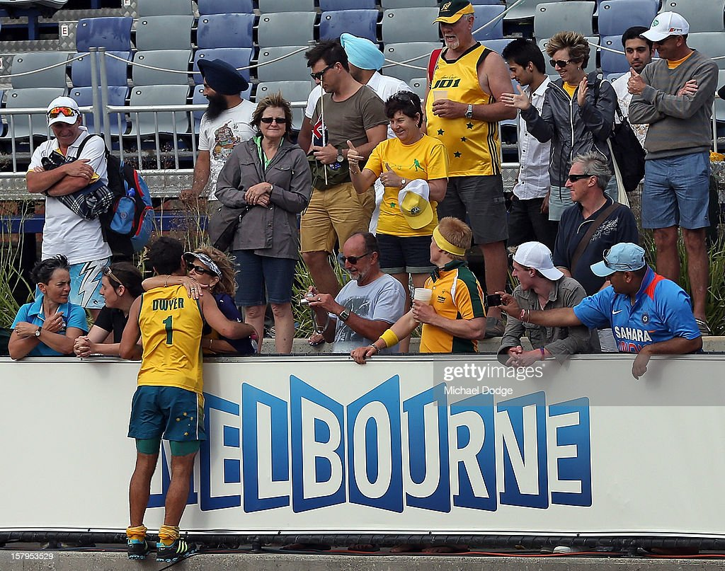 Jamie Dywer of Australia gets a hug from a fan after the match between Australia and India during day five of the 2012 Champions Trophy at the State Netball and Hockey Centre on December 8, 2012 in Melbourne, Australia.