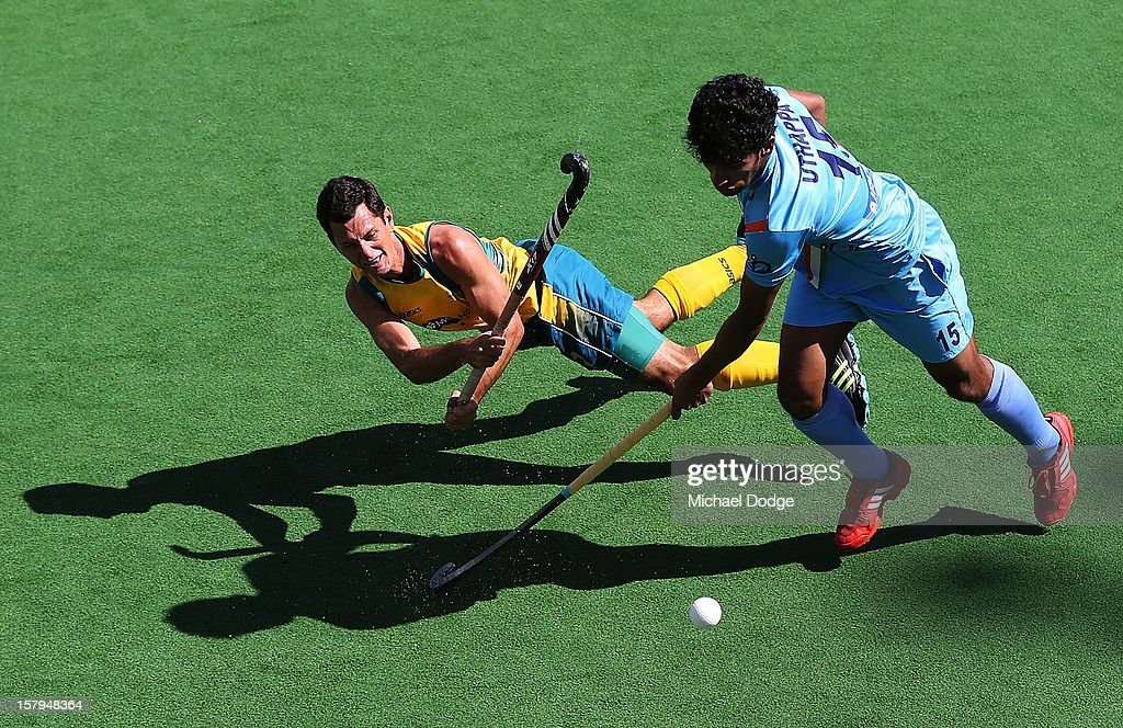 Jamie Dywer of Australia hits the ball past of India in the match between Australia and India during day five of the 2012 Champions Trophy at the State Netball and Hockey Centre on December 8, 2012 in Melbourne, Australia.