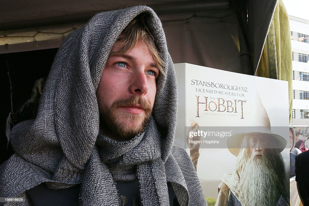 Jamie Eldridge poses inside the Stansborough stall with one of their woven cloaks woven during the Hobbit Artisan Market ahead of the 'The Hobbit: An Unexpected Journey' world premiere at Waitangi Park on November 25, 2012 in Wellington, New Zealand.