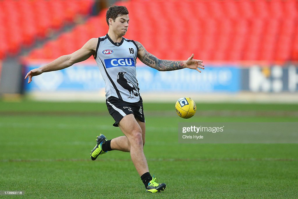 Jamie Elliott kicks during a Collingwood Magpies AFL training session at Metricon Stadium on July 19, 2013 in Gold Coast, Australia.
