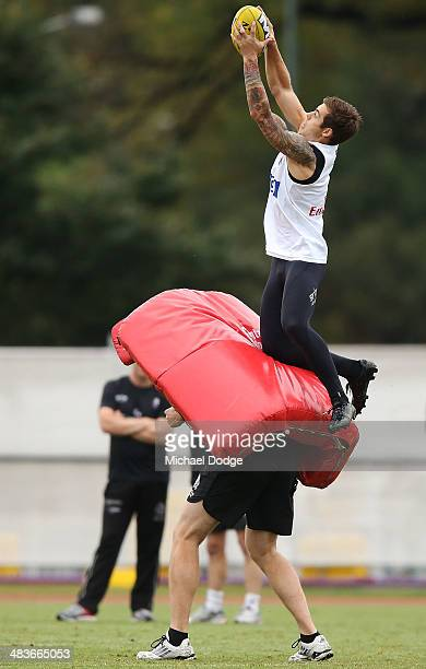Jamie Elliott marks the ball during a Collingwood Magpies AFL training session at Olympic Park on April 10 2014 in Melbourne Australia