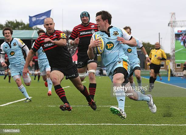 Jamie Elliott of Northampton breaks clear to score the first try during the Aviva Premiership semi final match between Saracens and Northampton...