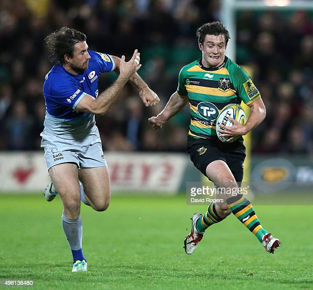 Jamie Elliott of Northampton moves away from Marcelo Bosch during the Aviva Premiership match between Northampton Saints and Saracens at Franklin's...
