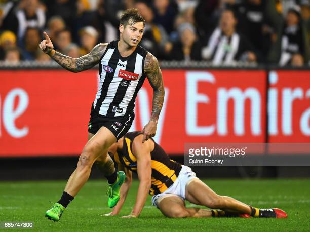 Jamie Elliott of the Magpies celebrates kicking a goal during the round nine AFL match between the Collingwood Magpies and the Hawthorn Hawks at...