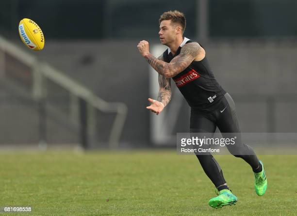 Jamie Elliott of the Magpies handballs during a Collingwood Magpies AFL training session at Olympic Park on May 11 2017 in Melbourne Australia