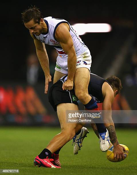 Jamie Elliott of the Magpies is challenged by Richard Douglas of the Crows during the round two AFL match between the Collingwood Magpies and the...