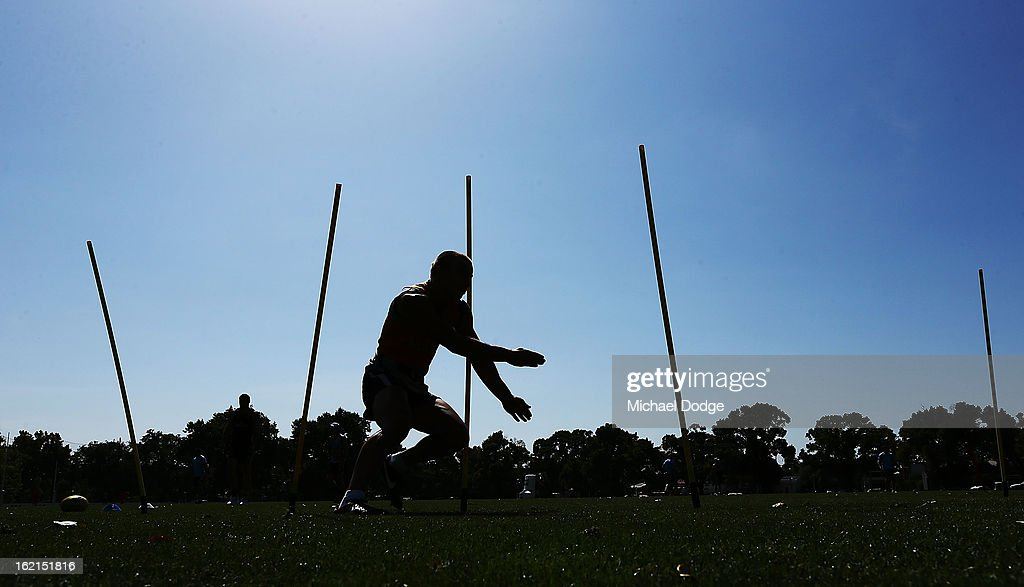 Jamie Elliott runs through an obstacle course during a Collingwood Magpies AFL training session at Gosch's Paddock on February 20, 2013 in Melbourne, Australia.