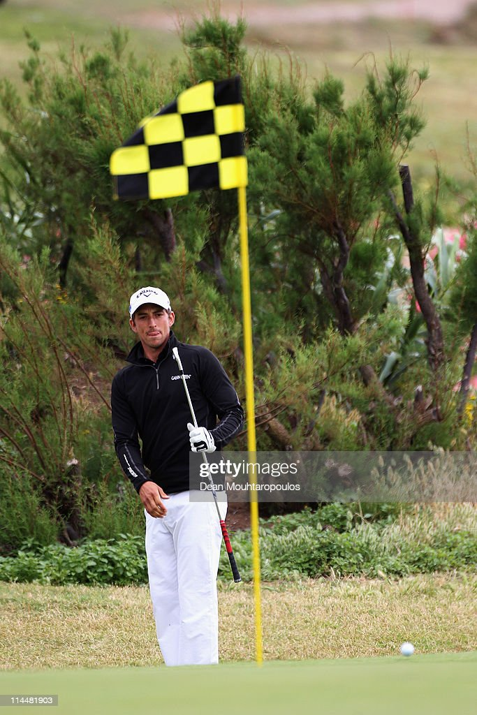 <a gi-track='captionPersonalityLinkClicked' href=/galleries/search?phrase=Jamie+Elson&family=editorial&specificpeople=220601 ng-click='$event.stopPropagation()'>Jamie Elson</a> of England hits his second shot on the 17th hole during day three of the Madeira Islands Open on May 21, 2011 in Porto Santo Island, Portugal.