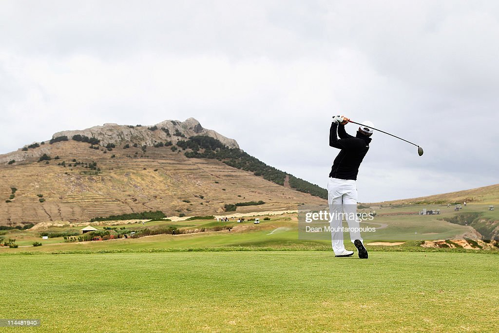<a gi-track='captionPersonalityLinkClicked' href=/galleries/search?phrase=Jamie+Elson&family=editorial&specificpeople=220601 ng-click='$event.stopPropagation()'>Jamie Elson</a> of England hits his tee shot on the 14th hole during day three of the Madeira Islands Open on May 21, 2011 in Porto Santo Island, Portugal.