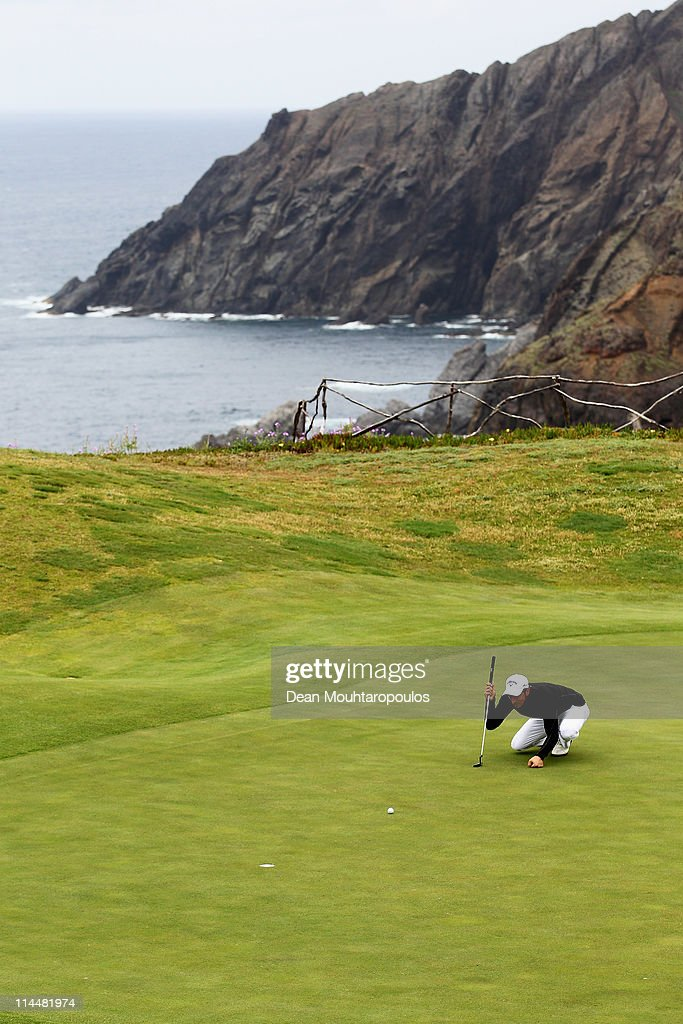 <a gi-track='captionPersonalityLinkClicked' href=/galleries/search?phrase=Jamie+Elson&family=editorial&specificpeople=220601 ng-click='$event.stopPropagation()'>Jamie Elson</a> of England lines up his putt on the 13th hole during day three of the Madeira Islands Open on May 21, 2011 in Porto Santo Island, Portugal.