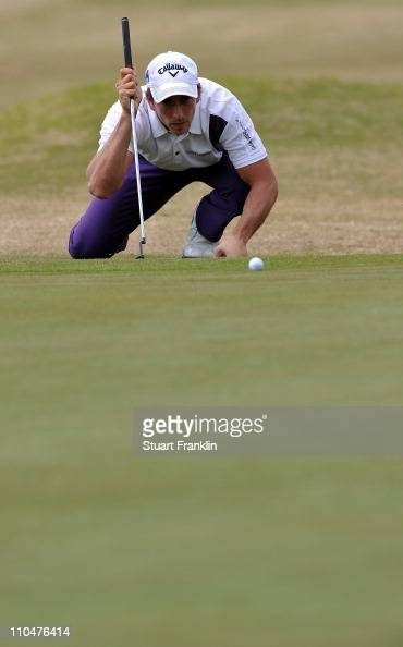 Jamie Elson of England lines up his putt on the eighth hole during the third round of the Sicilian Open at the Donnafugata golf resort and spa on...