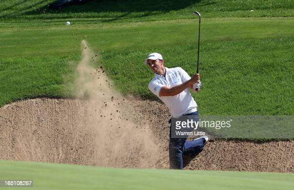Jamie Elson of England plays out of the 12th greenisde bunker during the third round of the Trophee du Hassan II at Golf du Palais Royal on March 30...