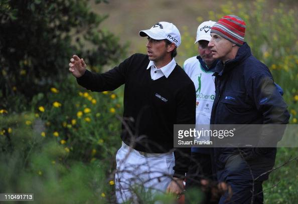 Jamie Elson of England talks with European Tour offical Mike Stewart on the 11th hole during the final round of the Sicilian Open at the Donnafugata...