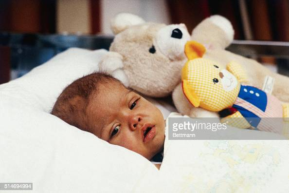 Jamie Fiske 1 years old liver transplant patient lying in bed with hewr stuffed animal in her University of Minnesota Hospital bed She looks sick and...