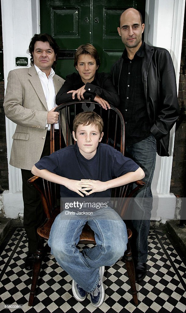 Jamie Foreman, Harry Eden, who plays the Artful Dodger, Mark Strong and Barney Clark (foreground), who plays Oliver Twis,t poses at the photocall for Roman Polanski's new production of Charles Dickens' ?Oliver Twist? outside the Dickens House Museum on September 26, 2005 in London, England.