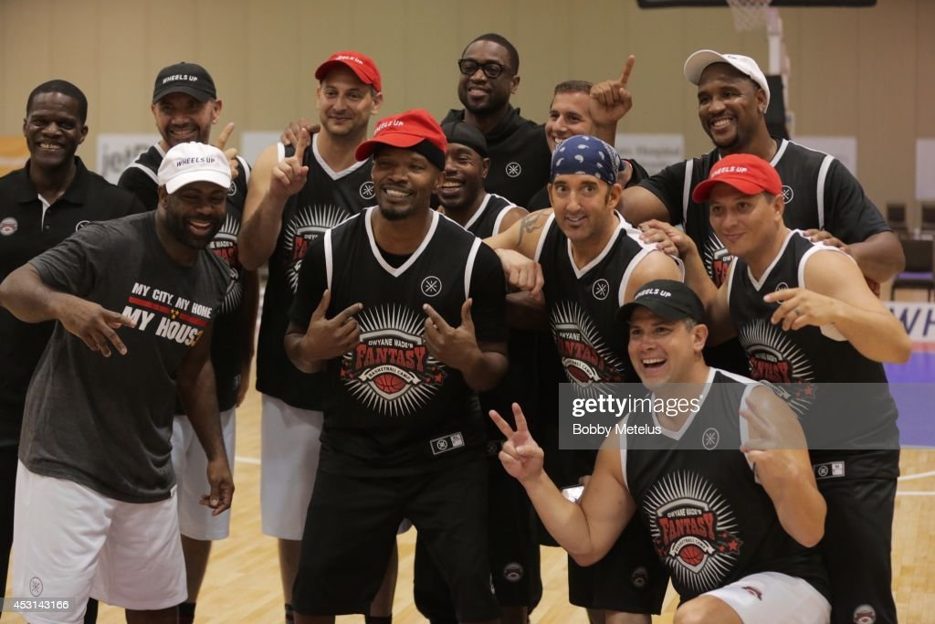 Jamie Foxx and Dwyane Wade during championship photos at Dwyane Wade's Fourth Annual Fantasy Basketball Camp at Westin Diplomat on August 3, 2014 in Hollywood, Florida.