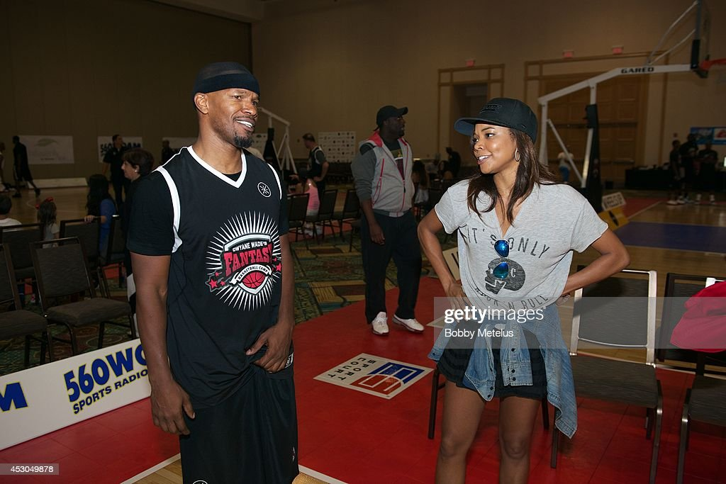 Jamie Foxx and Gabrielle Union share a laugh after a game at Dwyane Wade's Fourth Annual Fantasy Basketball Camp at Westin Diplomat on August 1, 2014 in Hollywood, Florida.
