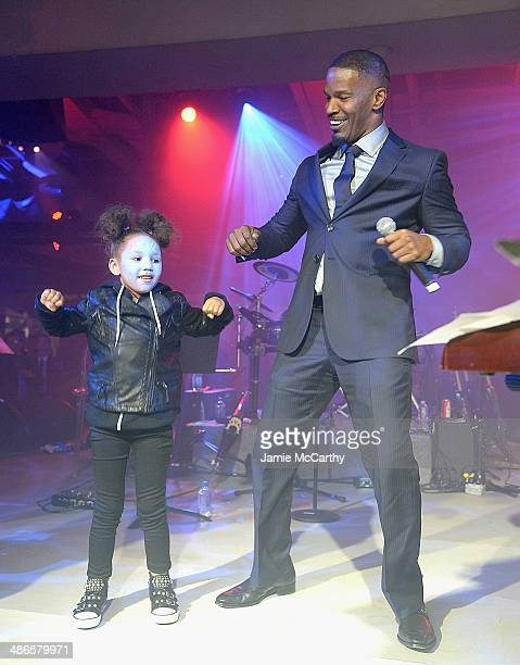 Jamie Foxx and his daughter Annalise dance on stage at the after party for 'The Amazing SpiderMan 2' premiere at Skylight at Moynihan Station on...