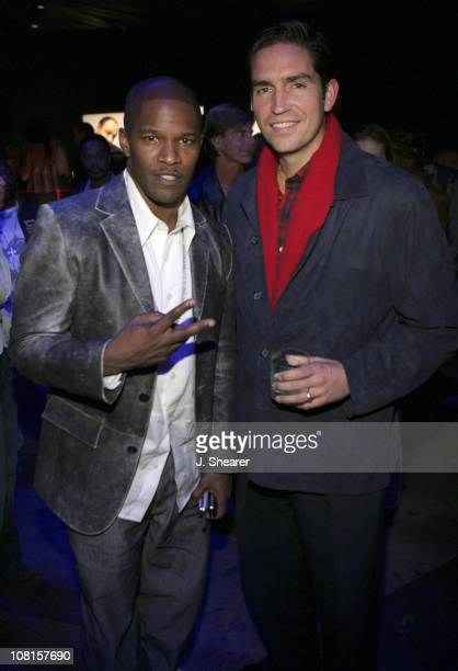 Jamie Foxx and Jim Caviezel during GQ Magazine Celebrates its 2004 Men of the Year After Party at Ago Restaurant in Los Angeles California United...