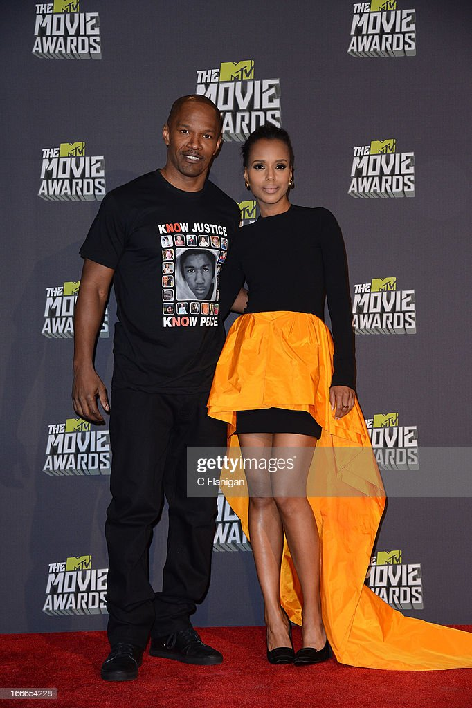 Jamie Foxx and Kerry Washington pose backstage during the 2013 MTV Movie Awards at Sony Pictures Studios on April 14, 2013 in Culver City, California.