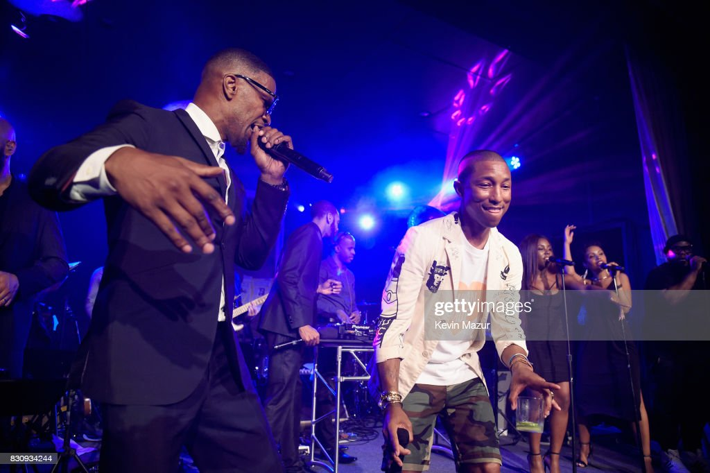 Jamie Foxx and Pharrell Williams perform onstage at Apollo in the Hamptons 2017: hosted by Ronald O. Perelman at The Creeks on August 12, 2017 in East Hampton, New York.